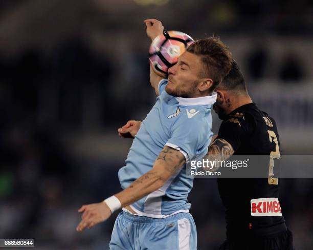 Elseid Hysaj of SSC Napoli competes for the ball with Ciro Immobile of SS Lazio during the Serie A match between SS Lazio and SSC Napoli at Stadio...