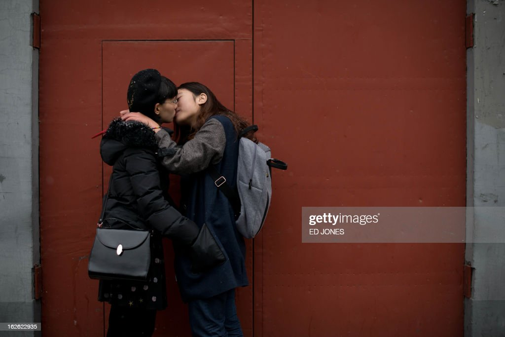 Elsie Liao (R) and Mayu Yu kiss in an alley outside the registry office where they asked to be married, before being turned away, in Beijing on February 25, 2013. Although not in a relationship together, the pair sought to draw attention to China's stance on same-sex marriage which is not recognised by law, the lack of access to social benefits available to couples, and to promote public awareness of discrimination against the LGBT community. China's government has an un-verified but widely reported 'three no's' policy towards homosexuality; no approval, no disapproval, no promotion. Same-sex acts were decriminalised in China in 1997, and homosexuality was removed from the country's mental illness list in 2001. As of June 2012 a 14-year-old ban was lifted allowing lesbians, although not gay men, to give blood. AFP PHOTO / Ed Jones