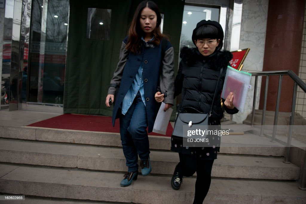 Elsie Liao (L) and Mayu Yu leave the registry office where they asked to be married, before being turned away, in Beijing on February 25, 2013. Although not in a relationship together, the pair sought to draw attention to China's stance on same-sex marriage which is not recognised by law, the lack of access to social benefits available to couples, and to promote public awareness of discrimination against the LGBT community. China's government has an un-verified but widely reported 'three no's' policy towards homosexuality; no approval, no disapproval, no promotion. Same-sex acts were decriminalised in China in 1997, and homosexuality was removed from the country's mental illness list in 2001. As of June 2012 a 14-year-old ban was lifted allowing lesbians, although not gay men, to give blood. AFP PHOTO / Ed Jones