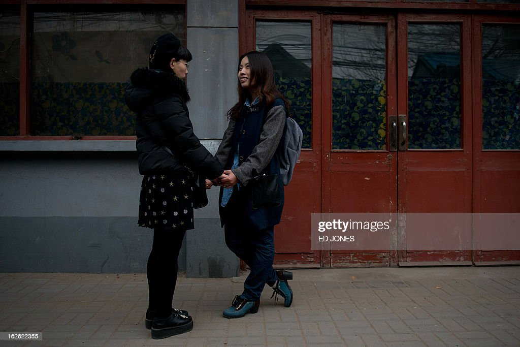Elsie Liao (R) and Mayu Yu (L) talk outside the registry office where they asked to be married, before being turned away, in Beijing on February 25, 2013. Although not in a relationship together, the pair sought to draw attention to China's stance on same-sex marriage which is not recognised by law, the lack of access to social benefits available to couples, and to promote public awareness of discrimination against the LGBT community. China's government has an un-verified but widely reported 'three no's' policy towards homosexuality; no approval, no disapproval, no promotion. Same-sex acts were decriminalised in China in 1997, and homosexuality was removed from the country's mental illness list in 2001. As of June 2012 a 14-year-old ban was lifted allowing lesbians, although not gay men, to give blood. AFP PHOTO / Ed Jones