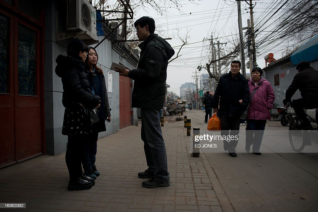 Elsie Liao (2nd L) and Mayu Yu (L) talk to a local reporter outside the registry office where they asked to be married, before being turned away, in Beijing on February 25, 2013. Although not in a relationship together, the pair sought to draw attention to China's stance on same-sex marriage which is not recognised by law, the lack of access to social benefits available to couples, and to promote public awareness of discrimination against the LGBT community. China's government has an un-verified but widely reported 'three no's' policy towards homosexuality; no approval, no disapproval, no promotion. Same-sex acts were decriminalised in China in 1997, and homosexuality was removed from the country's mental illness list in 2001. As of June 2012 a 14-year-old ban was lifted allowing lesbians, although not gay men, to give blood. AFP PHOTO / Ed Jones