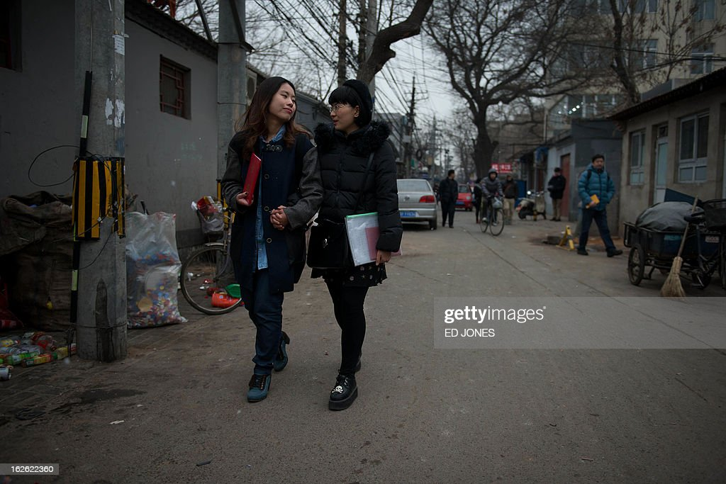 Elsie Liao (L) and Mayu Yu walk together near the registry office where they asked to be married, before being turned away, in Beijing on February 25, 2013. Although not in a relationship together, the pair sought to draw attention to China's stance on same-sex marriage which is not recognised by law, the lack of access to social benefits available to couples, and to promote public awareness of discrimination against the LGBT community. China's government has an un-verified but widely reported 'three no's' policy towards homosexuality; no approval, no disapproval, no promotion. Same-sex acts were decriminalised in China in 1997, and homosexuality was removed from the country's mental illness list in 2001. As of June 2012 a 14-year-old ban was lifted allowing lesbians, although not gay men, to give blood. AFP PHOTO / Ed Jones