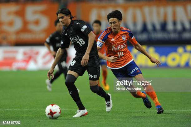 Elsinho of Kawasaki Frontale and Kisho Yano of Albirex Niigata compete for the ball during the JLeague J1 match between Albirex Niigata and Kawasaki...
