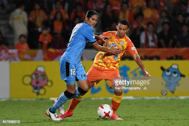 Elsinho of Kawasaki Frontale and Tiago Alves of Shimizu SPulse compete for the ball during the JLeague J1 match between Shimizu SPulse and Kawasaki...