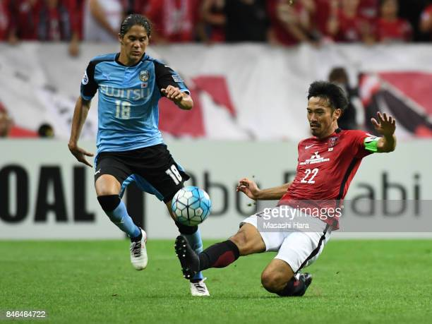 Elsinho of Kawasaki Frontale and Yuki Abe of Urawa Red Diamonds compete for the ball during the AFC Champions League quarter final second leg match...
