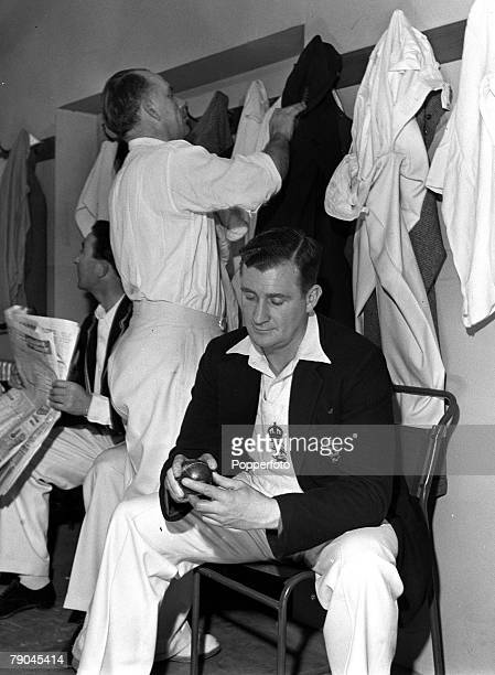 1952 Elstree Hertfordshire England England cricketer Denis Compton studies the sports pages and Cyril Washbrook changes while legendary spinner Jim...