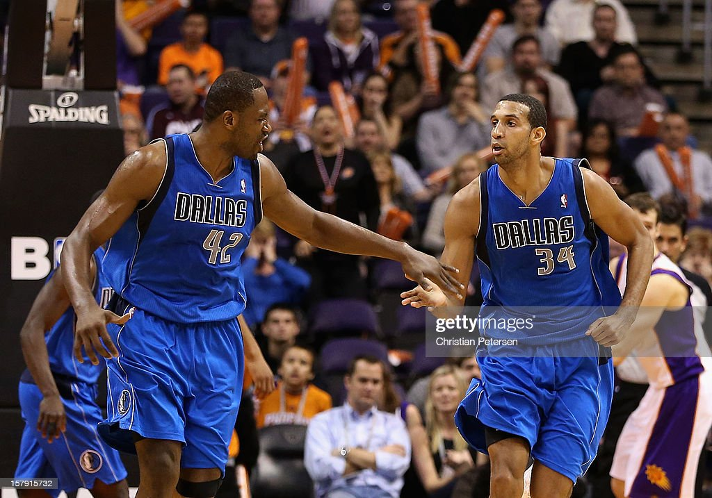 Elton Brand #42 and Brandan Wright #34 of the Dallas Mavericks high-five after scoring against the Phoenix Suns during the NBA game at US Airways Center on December 6, 2012 in Phoenix, Arizona. The Mavericks defeated the Suns 97-94.