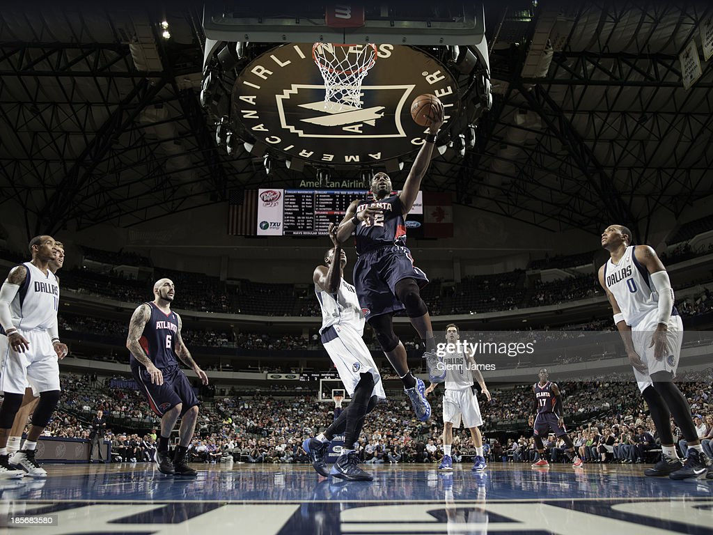 <a gi-track='captionPersonalityLinkClicked' href=/galleries/search?phrase=Elton+Brand&family=editorial&specificpeople=201501 ng-click='$event.stopPropagation()'>Elton Brand</a> #42 of the Atlanta Hawks goes in for the layup against Samuel Dalembert #1 of the Dallas Mavericks on October 23, 2013 at the American Airlines Center in Dallas, Texas.