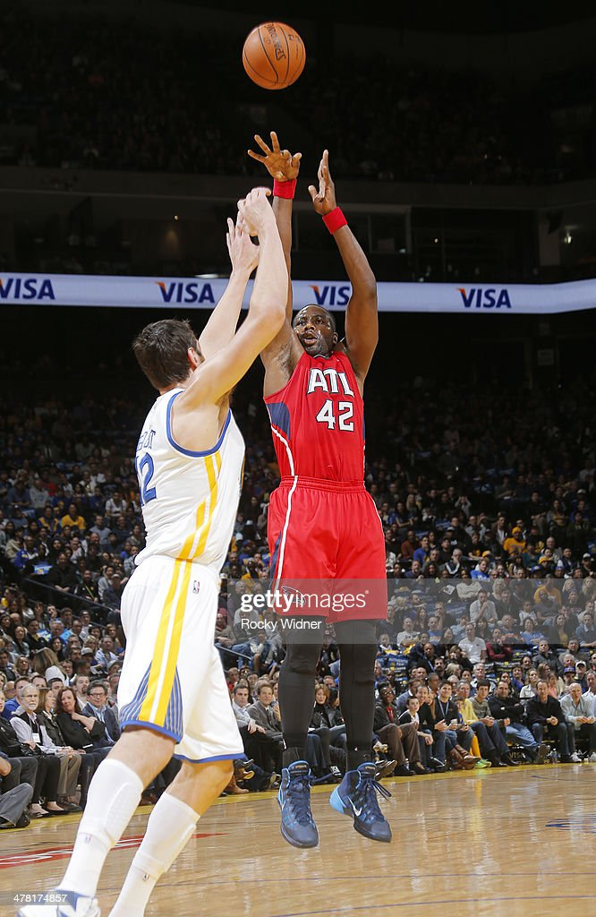 Elton Brand #42 of the Atlanta Hawks shoots against the Golden State Warriors on March 7, 2014 at Oracle Arena in Oakland, California.