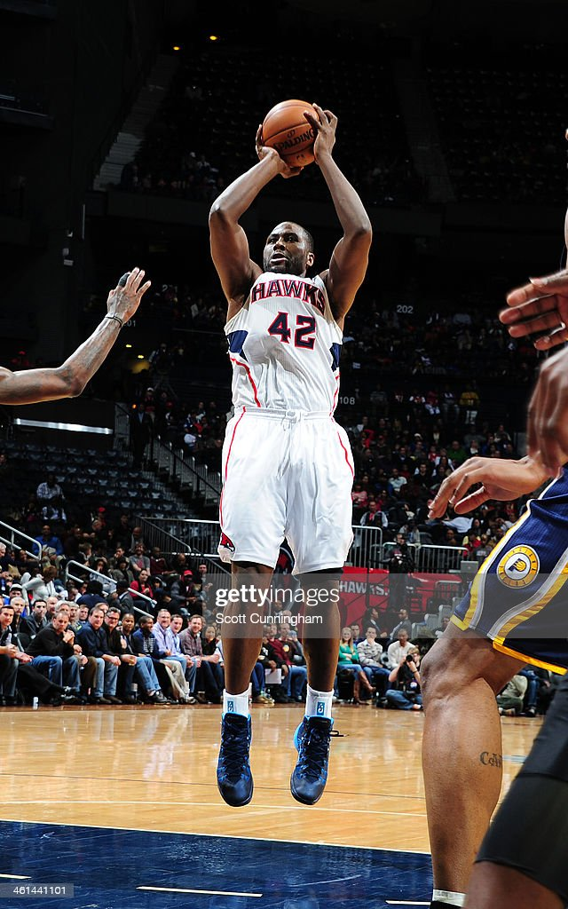 <a gi-track='captionPersonalityLinkClicked' href=/galleries/search?phrase=Elton+Brand&family=editorial&specificpeople=201501 ng-click='$event.stopPropagation()'>Elton Brand</a> #42 of the Atlanta Hawks taking a shot during a game against the Indiana Pacers of the Atlanta Hawks against of the Indiana Pacers on January 8, 2014 at Philips Arena in Atlanta, Georgia.