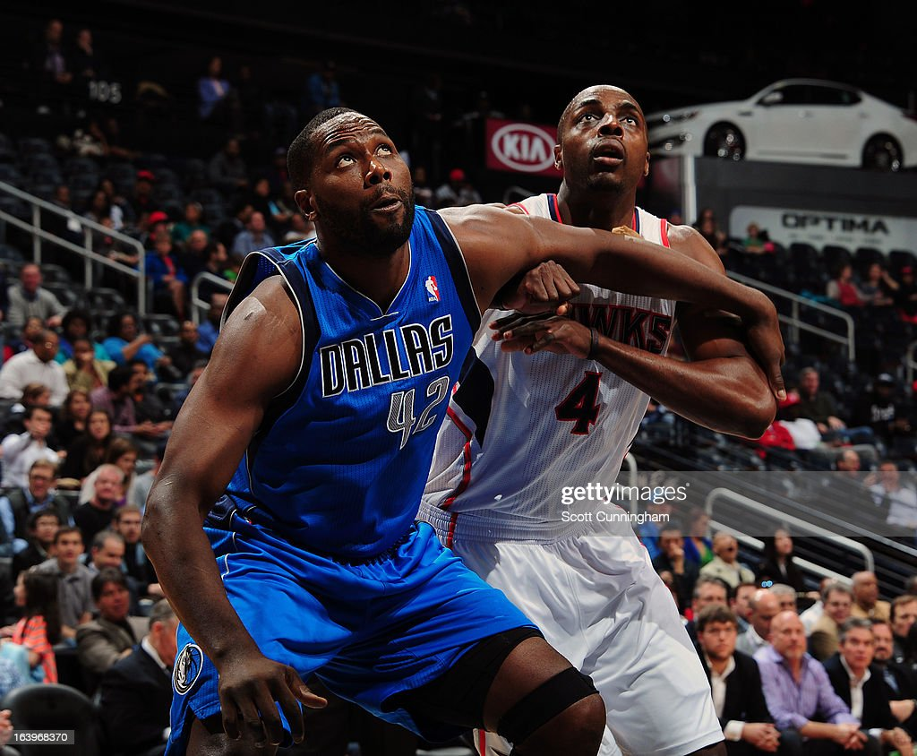 Elton Brand #42 of the Dallas Mavericks attempts to grab a rebound against Anthony Tolliver #4 of the Atlanta Hawks on March 18, 2013 at Philips Arena in Atlanta, Georgia.