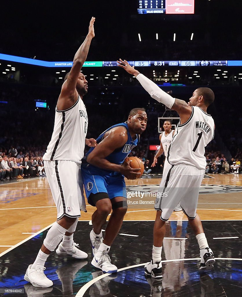 Elton Brand #42 of the Dallas Mavericks dribbles the ball through Andray Blatche #0 and C.J. Watson at the Barclays Center on March 1, 2013 in New York City.