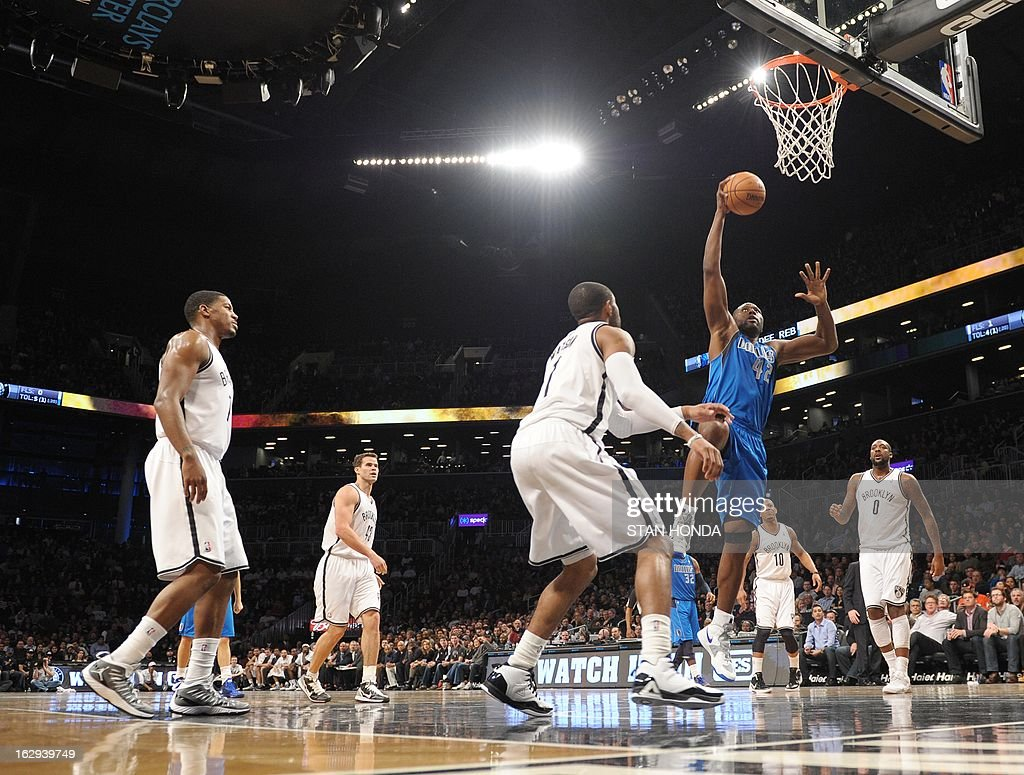 Elton Brand (R #42) of the Dallas Mavericks drives against C.J. Watson (C) of the Brooklyn Nets at the Barclays Center March 1, 2013 in the Brooklyn borough of New York. AFP PHOTO/Stan HONDA