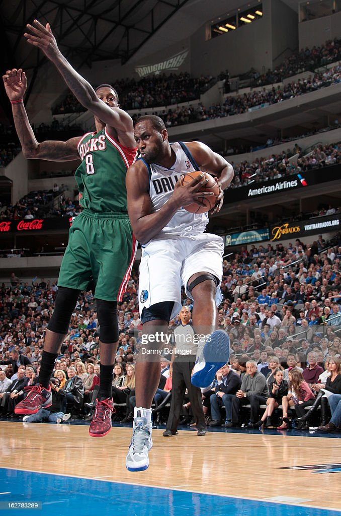 Elton Brand #42 of the Dallas Mavericks grabs a rebound against Larry Sanders #8 of the Milwaukee Bucks on February 26, 2013 at the American Airlines Center in Dallas, Texas.