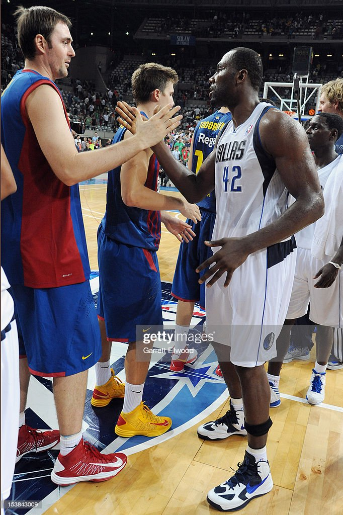 <a gi-track='captionPersonalityLinkClicked' href=/galleries/search?phrase=Elton+Brand&family=editorial&specificpeople=201501 ng-click='$event.stopPropagation()'>Elton Brand</a> #42 of the Dallas Mavericks high fives against FC Barcelona Regal during NBA Europe Live 2012 on October 9, 2012 at Palau Sant Jordi in Barcelona, Spain.