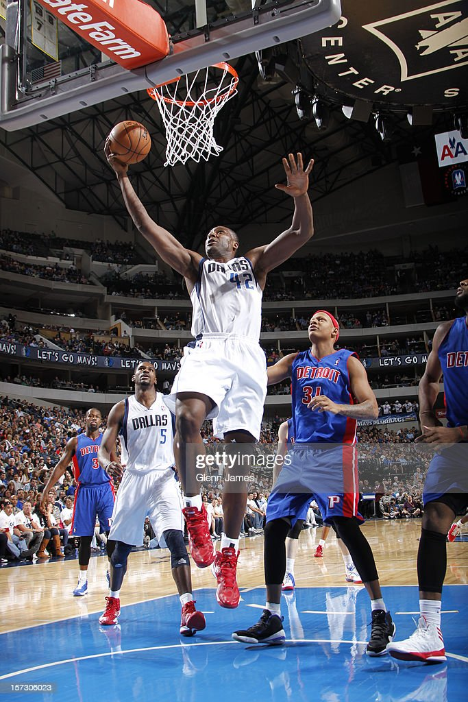 <a gi-track='captionPersonalityLinkClicked' href=/galleries/search?phrase=Elton+Brand&family=editorial&specificpeople=201501 ng-click='$event.stopPropagation()'>Elton Brand</a> #42 of the Dallas Mavericks lays it in against <a gi-track='captionPersonalityLinkClicked' href=/galleries/search?phrase=Charlie+Villanueva&family=editorial&specificpeople=215189 ng-click='$event.stopPropagation()'>Charlie Villanueva</a> #31 of the Detroit Pistons on December 1, 2012 at the American Airlines Center in Dallas, Texas.