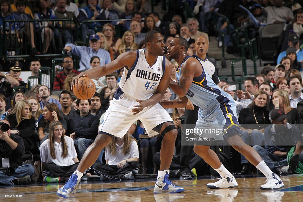 Elton Brand #42 of the Dallas Mavericks posts up against Darrell Arthur #00 of the Memphis Grizzlies on January 12, 2013 at the American Airlines Center in Dallas, Texas.