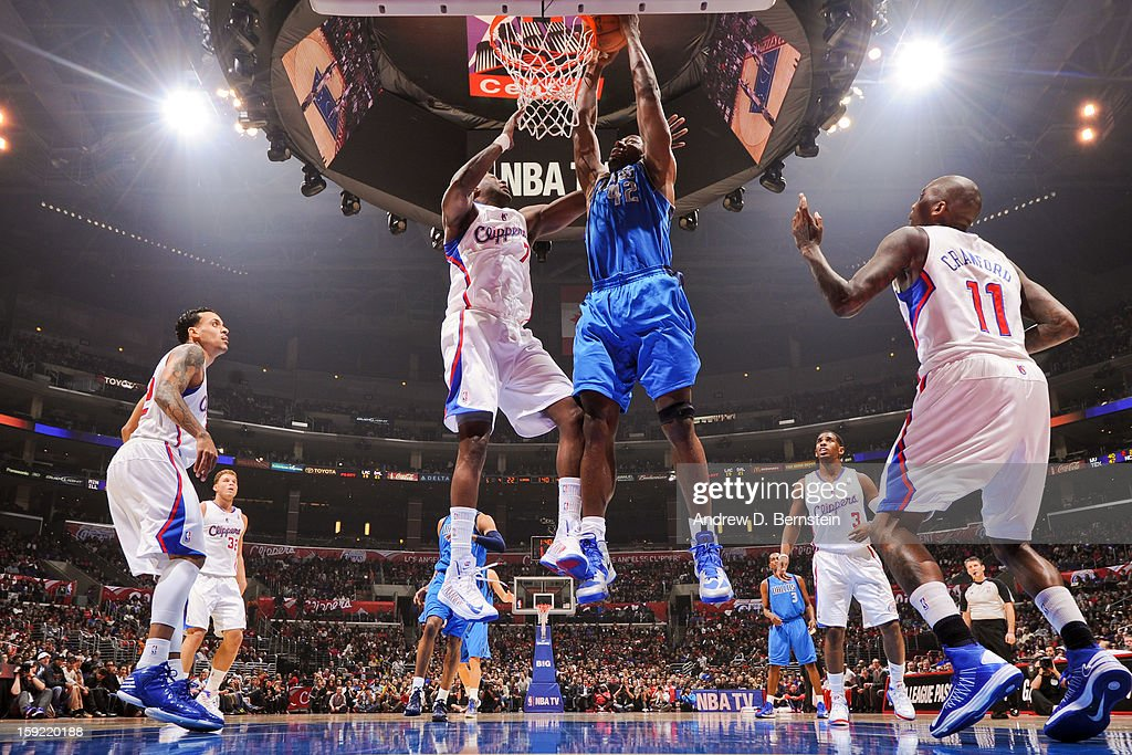 Elton Brand #42 of the Dallas Mavericks rises for a dunk against Lamar Odom #7 of the Los Angeles Clippers at Staples Center on January 9, 2013 in Los Angeles, California.