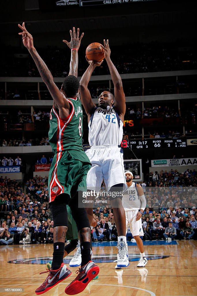 Elton Brand #42 of the Dallas Mavericks shoots against Larry Sanders #8 of the Milwaukee Bucks on February 26, 2013 at the American Airlines Center in Dallas, Texas.