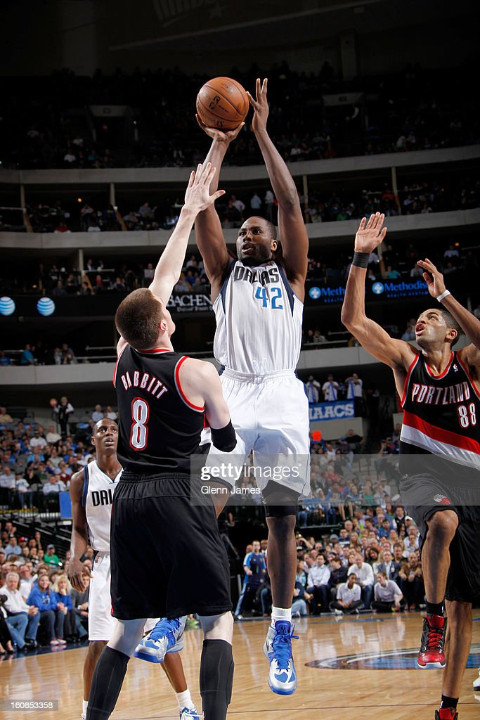 Elton Brand #42 of the Dallas Mavericks shoots against Luke Babbitt #8 of the Portland Trail Blazers on February 6, 2013 at the American Airlines Center in Dallas, Texas.