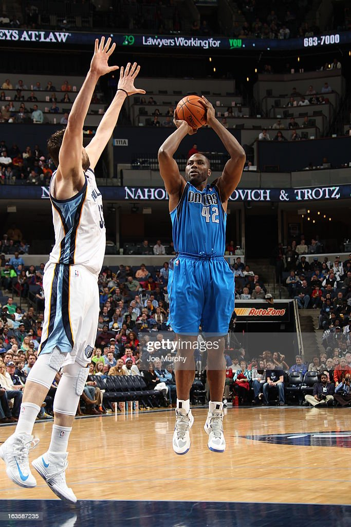<a gi-track='captionPersonalityLinkClicked' href=/galleries/search?phrase=Elton+Brand&family=editorial&specificpeople=201501 ng-click='$event.stopPropagation()'>Elton Brand</a> #42 of the Dallas Mavericks shoots against <a gi-track='captionPersonalityLinkClicked' href=/galleries/search?phrase=Marc+Gasol&family=editorial&specificpeople=661205 ng-click='$event.stopPropagation()'>Marc Gasol</a> #33 of the Memphis Grizzlies on February 27, 2013 at FedExForum in Memphis, Tennessee.