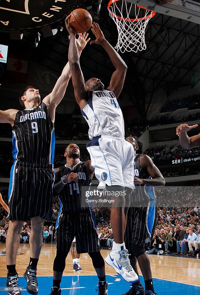 Elton Brand #42 of the Dallas Mavericks shoots against Nikola Vucevic #9 of the Orlando Magic on February 20, 2013 at the American Airlines Center in Dallas, Texas.
