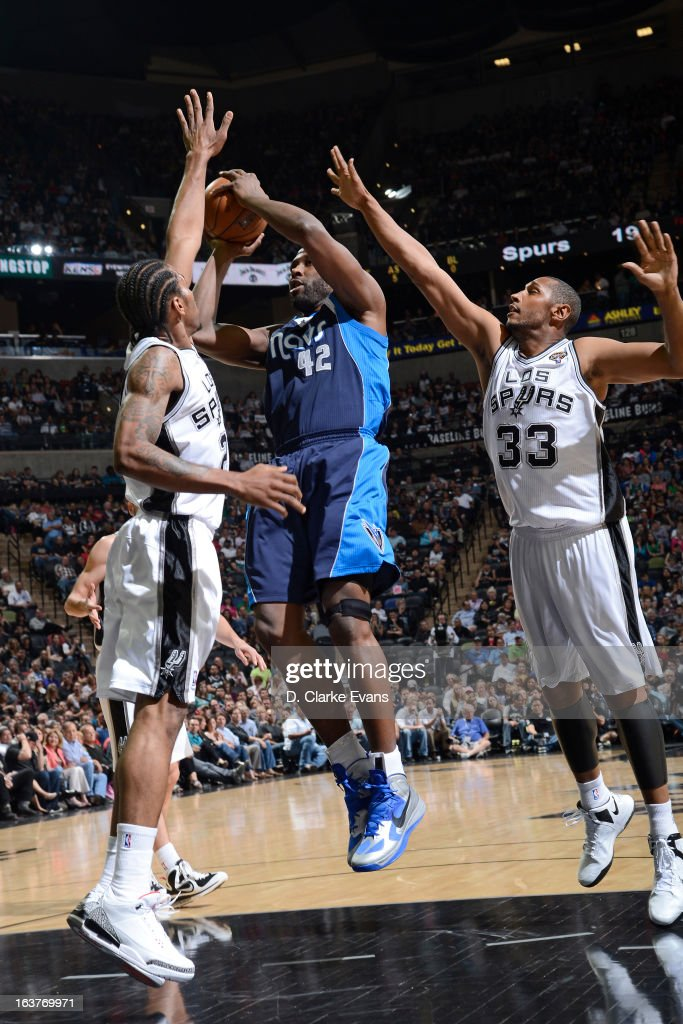 <a gi-track='captionPersonalityLinkClicked' href=/galleries/search?phrase=Elton+Brand&family=editorial&specificpeople=201501 ng-click='$event.stopPropagation()'>Elton Brand</a> #42 of the Dallas Mavericks shoots against the San Antonio Spurs on March 14, 2013 at the AT&T Center in San Antonio, Texas.