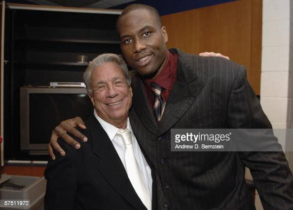 Elton Brand of the Los Angeles Clippers embraces Clippers Owner Donald Sterling after the win against the Denver Nuggets in game five of the Western...