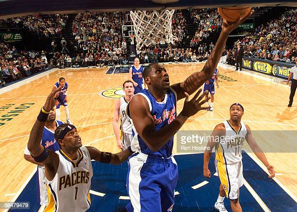 Elton Brand of the Los Angeles Clippers shoots over Stephen Jackson and Jamaal Tinsley of the Indiana Pacers at the Conseco Fieldhouse on December 21...