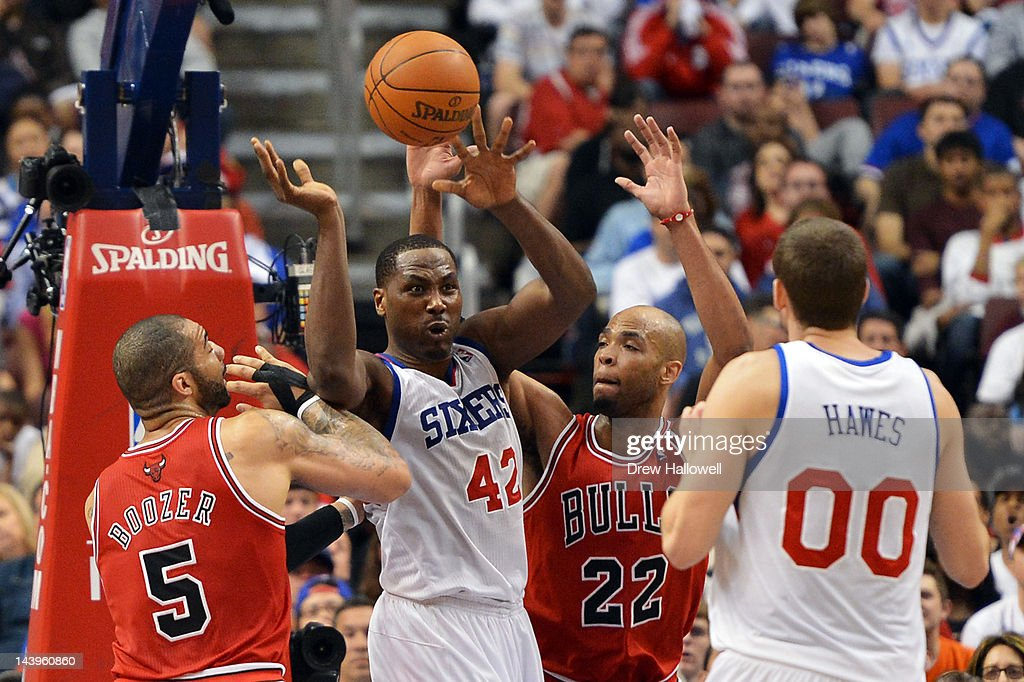 <a gi-track='captionPersonalityLinkClicked' href=/galleries/search?phrase=Elton+Brand&family=editorial&specificpeople=201501 ng-click='$event.stopPropagation()'>Elton Brand</a> #42 of the Philadelphia 76ers dishes off a pass to teammate <a gi-track='captionPersonalityLinkClicked' href=/galleries/search?phrase=Spencer+Hawes&family=editorial&specificpeople=3848319 ng-click='$event.stopPropagation()'>Spencer Hawes</a> #00 while being pressure by <a gi-track='captionPersonalityLinkClicked' href=/galleries/search?phrase=Carlos+Boozer&family=editorial&specificpeople=201638 ng-click='$event.stopPropagation()'>Carlos Boozer</a> #5 and <a gi-track='captionPersonalityLinkClicked' href=/galleries/search?phrase=Taj+Gibson&family=editorial&specificpeople=4029461 ng-click='$event.stopPropagation()'>Taj Gibson</a> #22 of the Chicago Bulls in Game Four of the Eastern Conference Quarterfinals in the 2012 NBA Playoffs at the Wells Fargo Center on May 6, 2012 in Philadelphia, Pennsylvania.