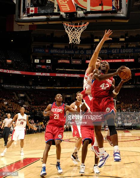 Elton Brand of the Philadelphia 76ers gets challenged under the basket by Andrea Bargnani of the Toronto Raptors on October 7 2009 at the Air Canada...