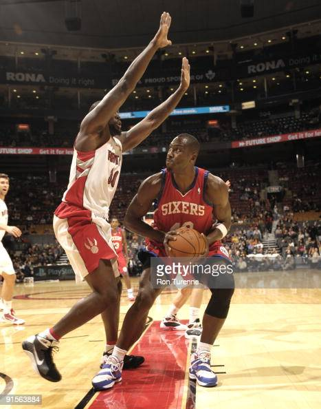 Elton Brand of the Philadelphia 76ers looks to make his move against Reggie Evans of the Toronto Raptors during a game on October 7 2009 at the Air...