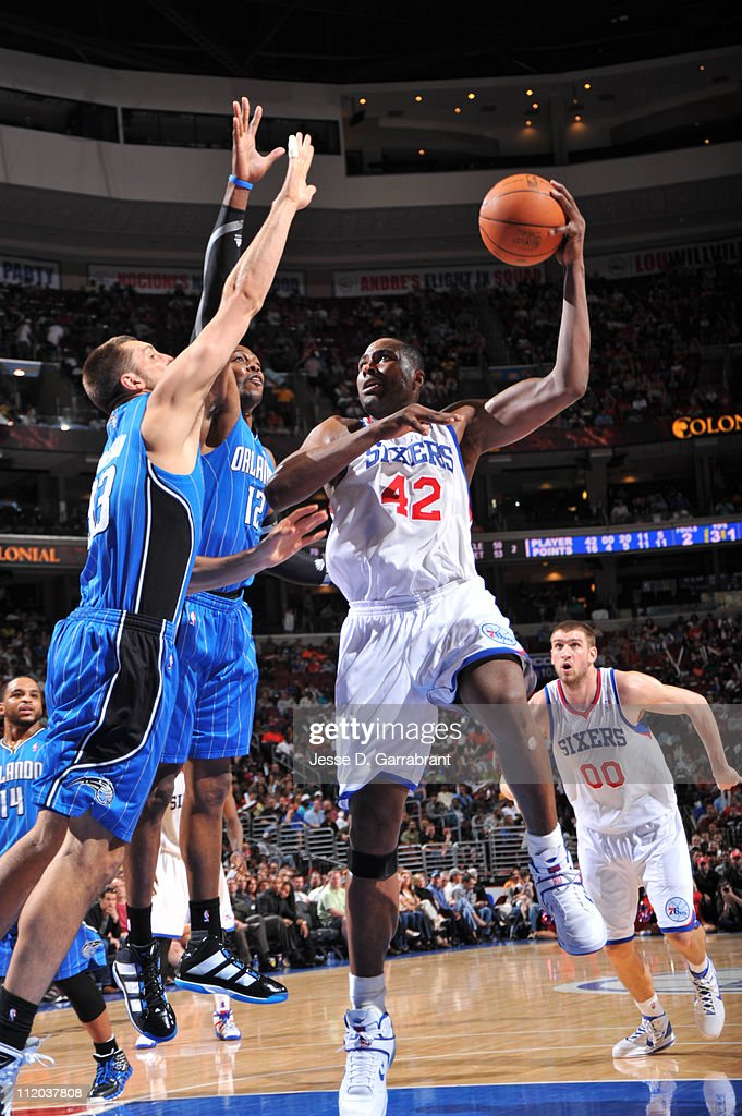 <a gi-track='captionPersonalityLinkClicked' href=/galleries/search?phrase=Elton+Brand&family=editorial&specificpeople=201501 ng-click='$event.stopPropagation()'>Elton Brand</a> #42 of the Philadelphia 76ers shoots against <a gi-track='captionPersonalityLinkClicked' href=/galleries/search?phrase=Dwight+Howard&family=editorial&specificpeople=201570 ng-click='$event.stopPropagation()'>Dwight Howard</a> #12 and Ryan Anderson #33 of the Orlando Magic on April 11, 2011 at the Wells Fargo Center in Philadelphia, Pennsylvania.