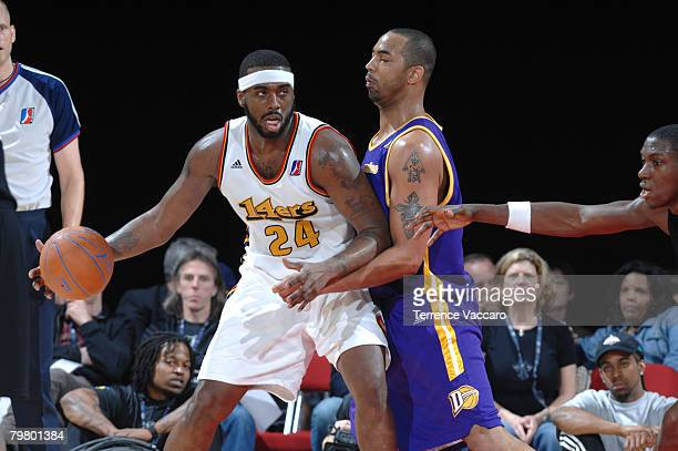Elton Brown of the Red Team posts up against Jelani McCoy of the Blue Team during the DLeague AllStar Game presented by Spalding on center court at...