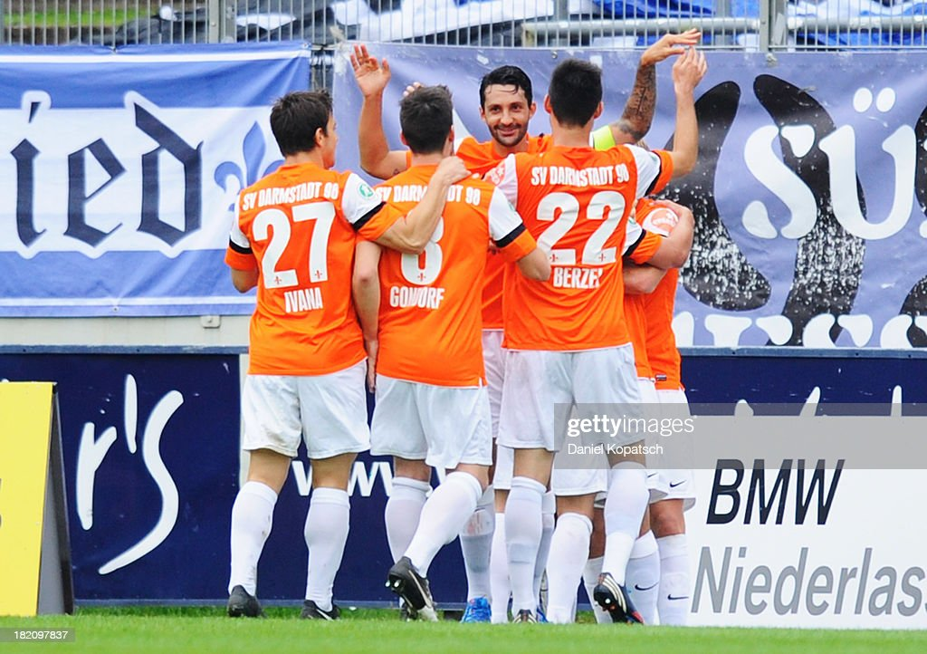 Elton da Costa of Darmstadt (hidden) celebrates his team's first goal with team mates during the third Bundesliga match between 1. FC Saarbruecken and Darmstadt 98 on September 28, 2013 in Saarbruecken, Germany.