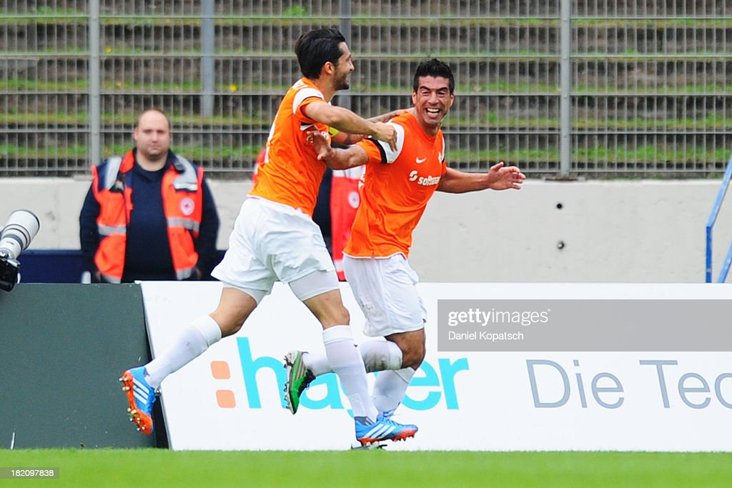 Elton da Costa of Darmstadt (R) celebrates his team's first goal with team mate Aytac Sulu during the third Bundesliga match between 1. FC Saarbruecken and Darmstadt 98 on September 28, 2013 in Saarbruecken, Germany.