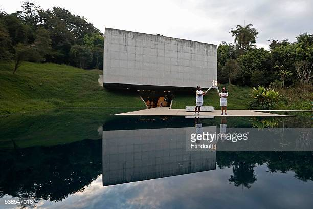 Elton Damasceno and Isabel Steps Olympic Torch at Inhotim Institute on day 11 during the Olympic Flame torch relay on May 13 2016 in Brumadinho...