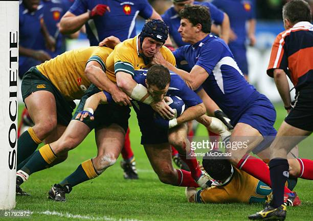 Elton Flatley of Australia holds up France's Frederic Michalak short of the try line during the Rugby Union International between France and...
