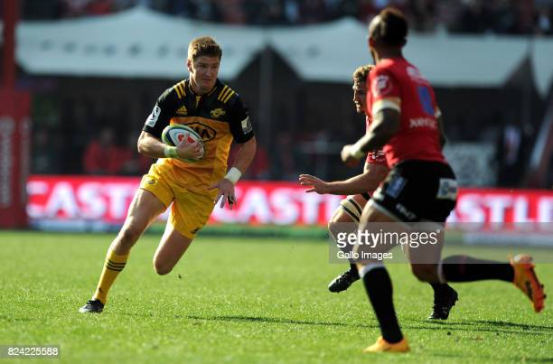 Elton Jantjies and Kwagga Smith of Lions in action with Jordie Barrett of Hurricanes during the Super Rugby Semi Final match between Emirates Lions...