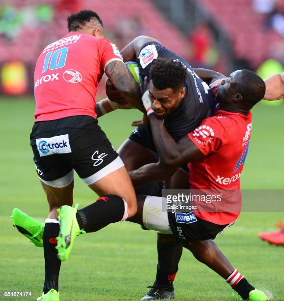 Elton Jantjies and Madosh Tambwe of the Lions tackle Samu Kerevi of the Reds during the Super Rugby match between Emirates Lions and Reds at Emirates...
