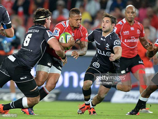 Elton Jantjies of the Lions gets tackled by Marcell Coetzee and Cobus Reinach during the Super Rugby match between Emirates Lions and Cell C Sharks...