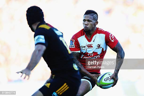 Elton Jantjies of the Lions looks to pass the ball out during the round two Super Rugby match between the Chiefs and the Lions at FMG Stadium on...