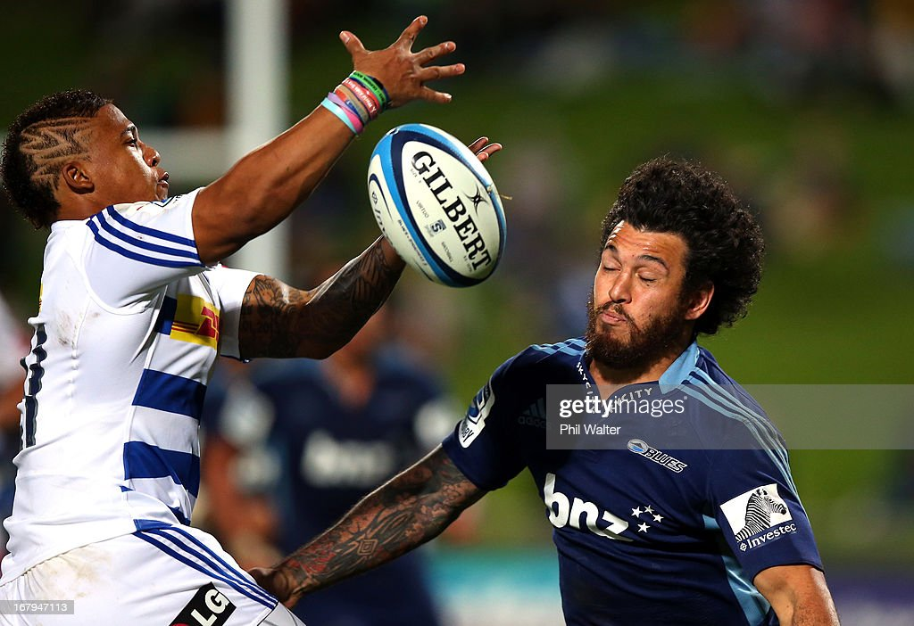Elton Jantjies of the Stormers collects the loose ball under pressure from Rene Ranger of the Blues during the round 12 Super Rugby match between the Blues and the Stormers at North Harbour Stadium on May 3, 2013 in Auckland, New Zealand.