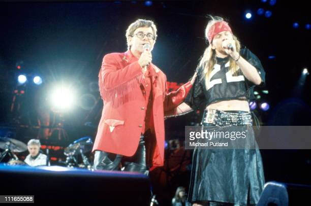 Elton John and Axl Rose of Guns N' Roses perform on stage at the Freddie Mercury Tribute Concert Wembley Stadium London 20th April 1992