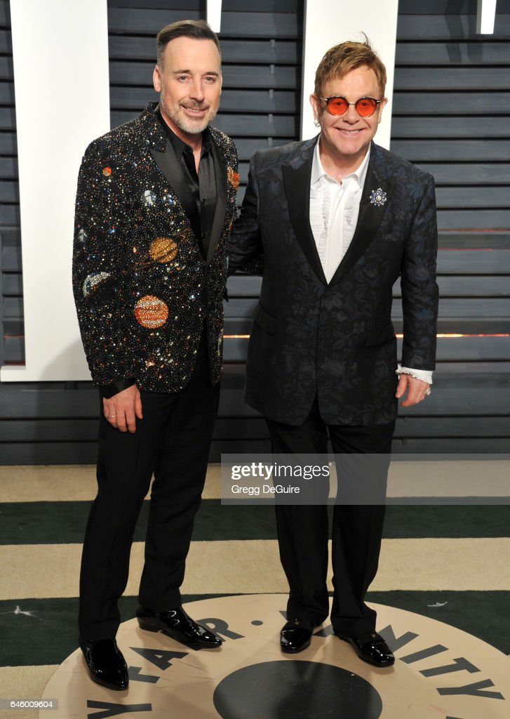 Elton John and David Furnish arrive at the 2017 Vanity Fair Oscar Party Hosted By Graydon Carter at Wallis Annenberg Center for the Performing Arts on February 26, 2017 in Beverly Hills, California.