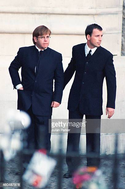 Elton John and David Furnish arrive at The Funeral of Diana Princess of Wales at Westminster Abbey London on September 6 in London England
