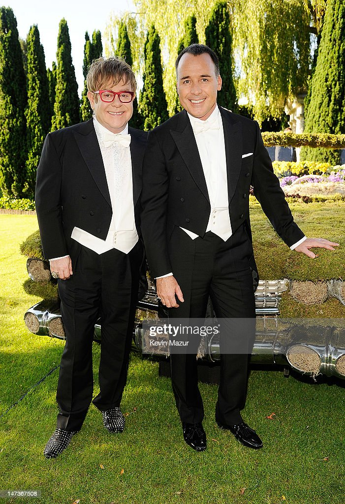 (L-R) <a gi-track='captionPersonalityLinkClicked' href=/galleries/search?phrase=Elton+John&family=editorial&specificpeople=171369 ng-click='$event.stopPropagation()'>Elton John</a> and <a gi-track='captionPersonalityLinkClicked' href=/galleries/search?phrase=David+Furnish&family=editorial&specificpeople=220203 ng-click='$event.stopPropagation()'>David Furnish</a> arrive for The 14th Annual White Tie and Tiara Ball to Benefit <a gi-track='captionPersonalityLinkClicked' href=/galleries/search?phrase=Elton+John&family=editorial&specificpeople=171369 ng-click='$event.stopPropagation()'>Elton John</a> AIDS Foundation in Association with Chopard at Woodside on June 28, 2012 in Windsor, England. NO UK SALES BEFORE 17TH JULY 2012. NO HELLO, NOW, CLOSER, REVEAL, HEAT, LOOK OR GRAZIA SALES IN THE UK EVER. NO ITALY SALES BEFORE 4TH JULY 2012, NO SPAIN SALES BEFORE 7TH JULY 2012, NO MEXICO SALES BEFORE 1ST AUGUST 2012. All pictures are for editorial use only and mention of 'Chopard' and 'The <a gi-track='captionPersonalityLinkClicked' href=/galleries/search?phrase=Elton+John&family=editorial&specificpeople=171369 ng-click='$event.stopPropagation()'>Elton John</a> Aids Foundation' are compulsory. No sales ever to any jewellers other than Chopard