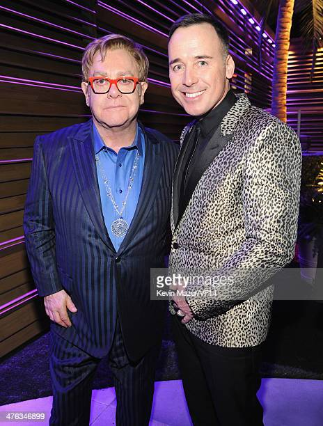 Elton John and David Furnish attend the 2014 Vanity Fair Oscar Party Hosted By Graydon Carter on March 2 2014 in West Hollywood California