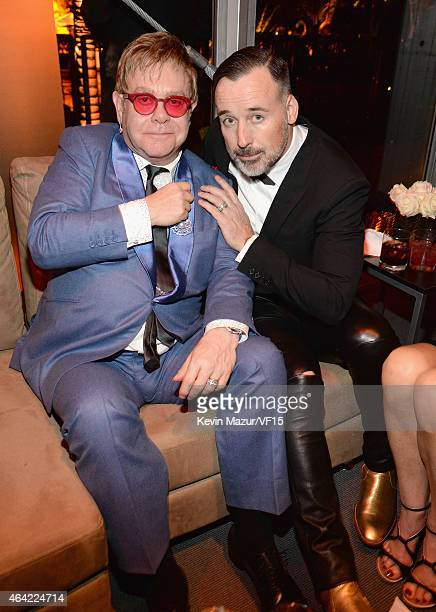 Elton John and David Furnish attend the 2015 Vanity Fair Oscar Party hosted by Graydon Carter at the Wallis Annenberg Center for the Performing Arts...