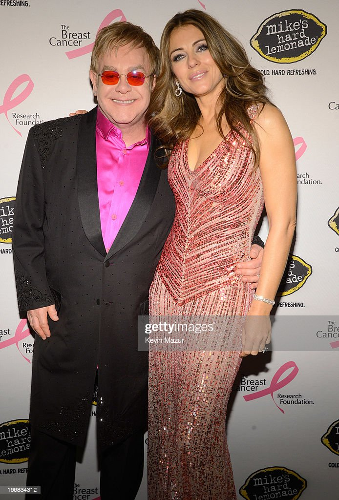 <a gi-track='captionPersonalityLinkClicked' href=/galleries/search?phrase=Elton+John&family=editorial&specificpeople=171369 ng-click='$event.stopPropagation()'>Elton John</a> and <a gi-track='captionPersonalityLinkClicked' href=/galleries/search?phrase=Elizabeth+Hurley&family=editorial&specificpeople=201731 ng-click='$event.stopPropagation()'>Elizabeth Hurley</a> attend the Breast Cancer Foundation's Hot Pink Party at the Waldorf Astoria Hotel on April 17, 2013 in New York City.